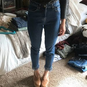 Classic high waisted blue jeans with ankle fringe